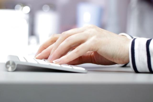 working typing keyboard desk hands