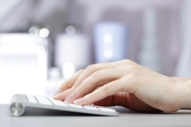 work working desk hands typing keyboard