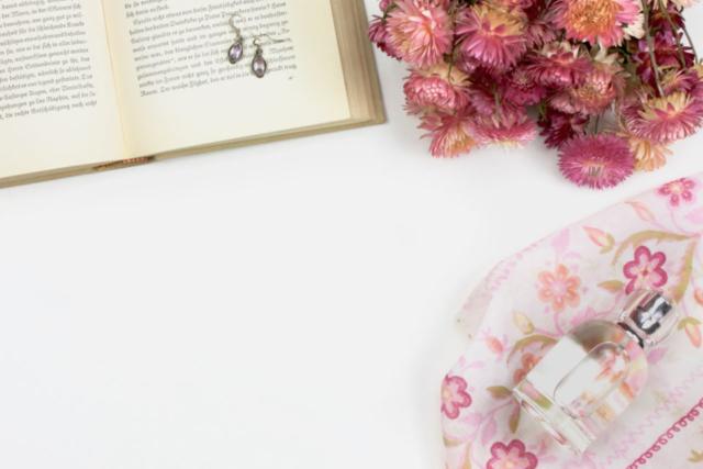 beauty flatlay flowers earrings book scarf perfume