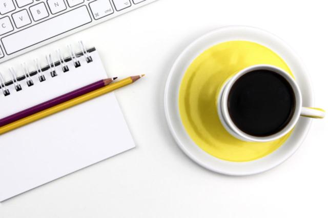 working desk pencils coffee keyboard